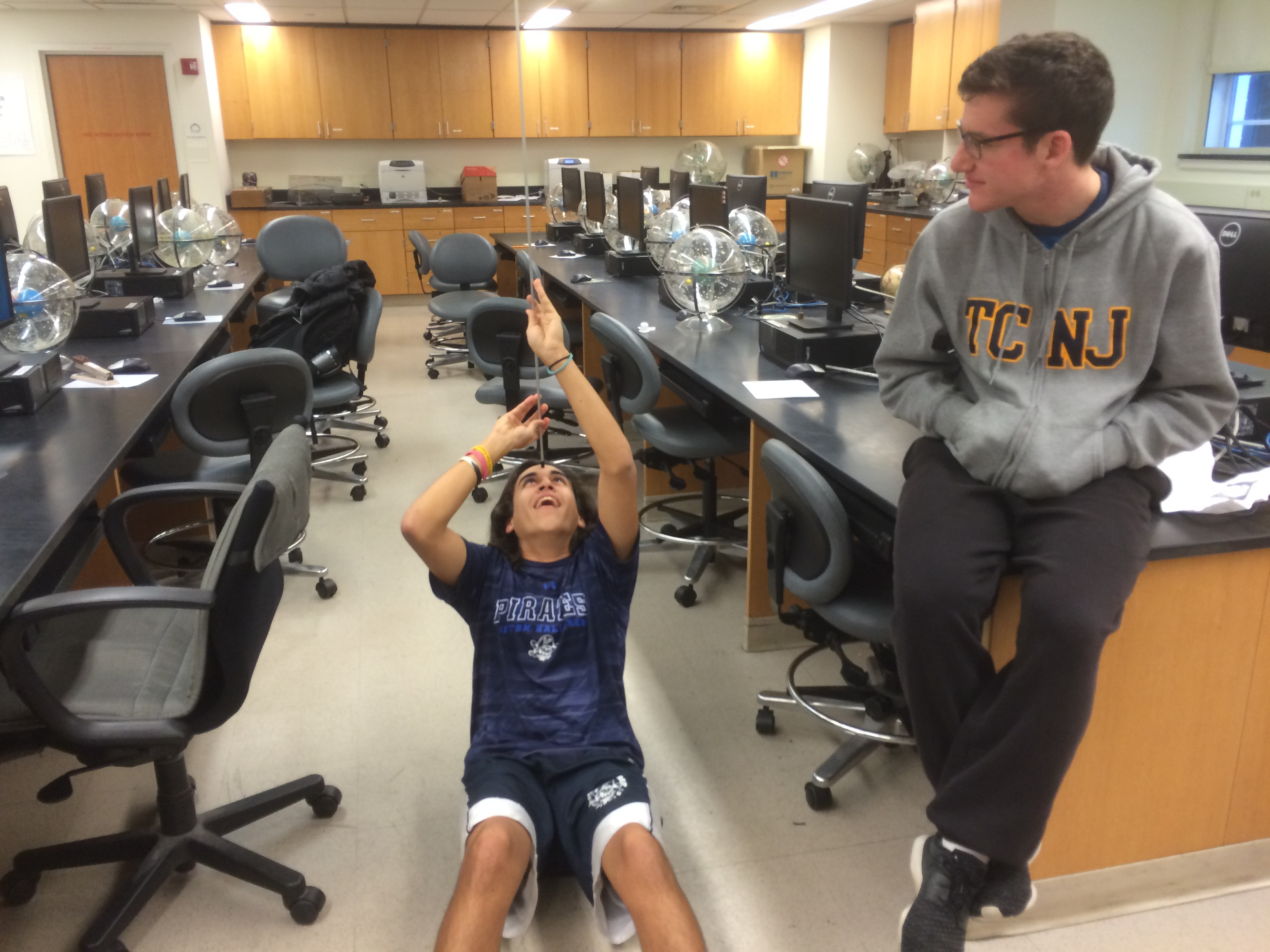 Students messing around in Physics classroom