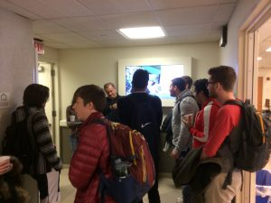 Students in hallway of Physics building